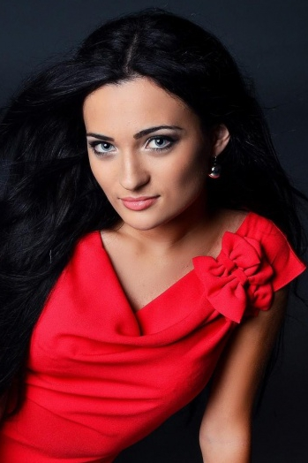Ukrainian girl Natalia,24 years old with blue eyes and black hair.