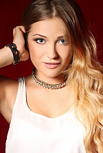 Ukrainian girl Olga,24 years old with blue eyes and blonde hair.