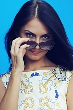 Ukrainian girl Elena,27 years old with blue eyes and black hair.