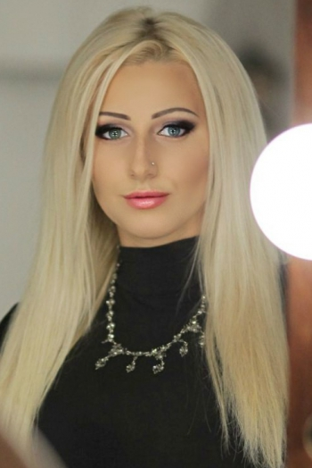 Ukrainian girl Elena,30 years old with green eyes and blonde hair.