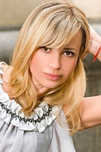 Ukrainian girl Inna,44 years old with brown eyes and blonde hair.