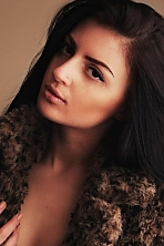 Ukrainian girl Zorianna,24 years old with brown eyes and black hair.