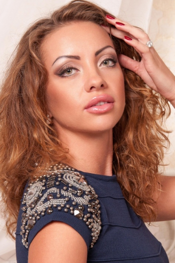 Ukrainian girl Ruslana,27 years old with green eyes and light brown hair.