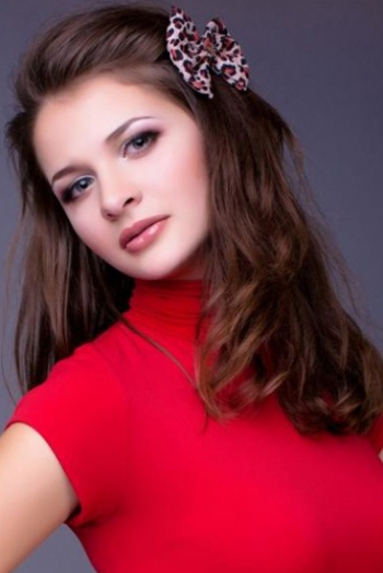 Ukrainian girl Olga,25 years old with green eyes and dark brown hair.