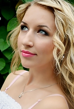Ukrainian girl Katerina,22 years old with blue eyes and blonde hair.