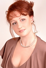 Ukrainian girl Julia,41 years old with brown eyes and red hair.