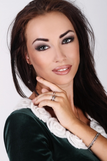 Ukrainian girl Tamara,24 years old with grey eyes and dark brown hair.