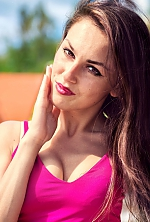 Ukrainian girl Marina,27 years old with brown eyes and dark brown hair.