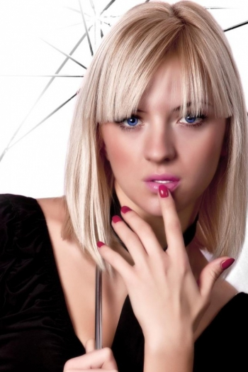 Ukrainian girl Larisa,32 years old with blue eyes and blonde hair.