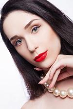 Ukrainian girl Yana,24 years old with grey eyes and dark brown hair.