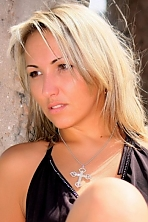 Ukrainian girl Tatiana,36 years old with brown eyes and blonde hair.
