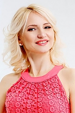 Ukrainian girl Ruslana,50 years old with green eyes and light brown hair.