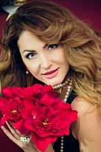 Ukrainian girl Margaret,51 years old with grey eyes and red hair.