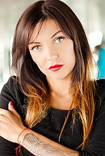 Ukrainian girl Alyona,31 years old with blue eyes and black hair.