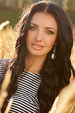 Ukrainian girl Svetlana,32 years old with green eyes and black hair.