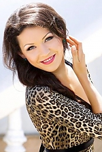 Ukrainian girl Anna,30 years old with green eyes and dark brown hair.