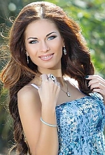 Ukrainian girl Nina,26 years old with green eyes and dark brown hair.