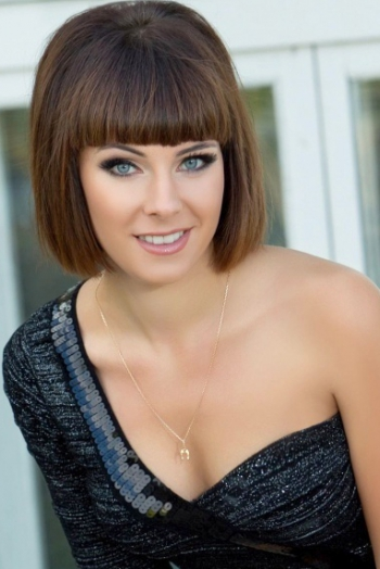 Ukrainian girl Natalia,25 years old with green eyes and dark brown hair.