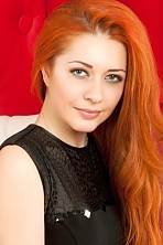 Ukrainian girl Lilia,25 years old with green eyes and red hair.