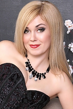 Ukrainian girl Nataly,37 years old with green eyes and blonde hair.