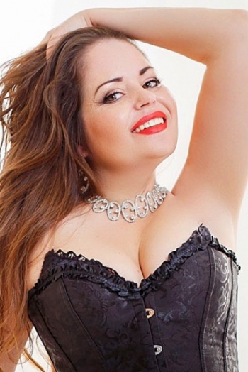 Ukrainian girl Svetlana,38 years old with green eyes and light brown hair.