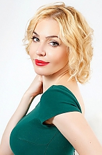 Ukrainian girl Taisiya,38 years old with green eyes and blonde hair.