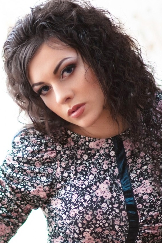 Ukrainian girl Ella,27 years old with green eyes and dark brown hair.