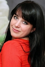 Ukrainian girl Larisa,40 years old with green eyes and black hair.
