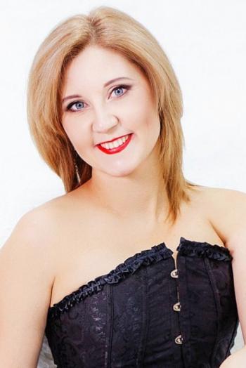 Ukrainian girl Tatiana,41 years old with blue eyes and dark brown hair.