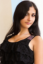 Ukrainian girl Hristina,23 years old with brown eyes and black hair.