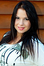 Ukrainian girl Anna,22 years old with hazel eyes and dark brown hair.