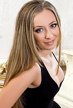 Ukrainian girl Elena,28 years old with blue eyes and light brown hair.