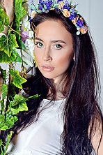 Ukrainian girl Maria,20 years old with green eyes and black hair.