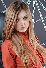 Ukrainian girl Vasilisa,25 years old with grey eyes and light brown hair.