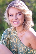Ukrainian girl Ksenia,28 years old with green eyes and blonde hair.