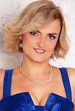 Ukrainian girl Nataliya,40 years old with green eyes and blonde hair.