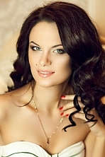 Ukrainian girl Ekaterina,27 years old with green eyes and dark brown hair.