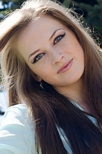 Ukrainian girl Galya,23 years old with blue eyes and dark brown hair.