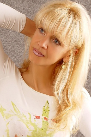Ukrainian girl Natalia,53 years old with blue eyes and blonde hair.