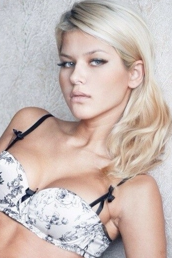 Russian girl Alina,26 years old with blue eyes and blonde hair.