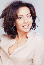 Ukrainian girl Anna,44 years old with grey eyes and dark brown hair.