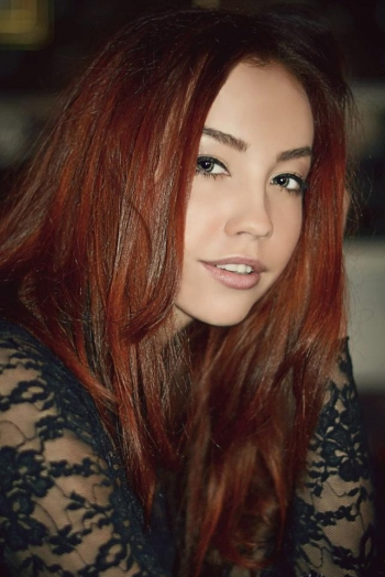 Ukrainian girl Ekaterina,22 years old with grey eyes and red hair.