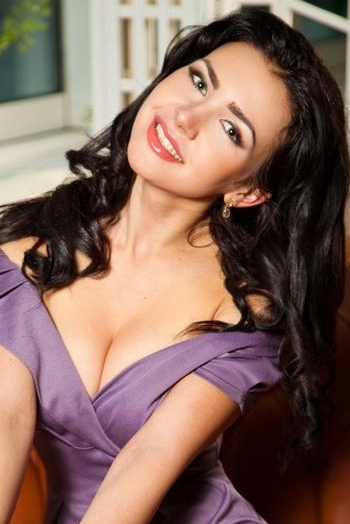 Ukrainian girl Yulia,27 years old with green eyes and black hair.