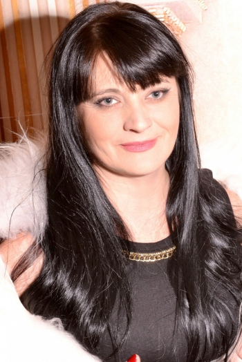 Ukrainian girl Oksana,48 years old with grey eyes and black hair.