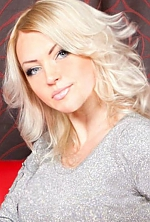 Ukrainian girl Anna,35 years old with blue eyes and blonde hair.