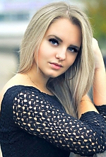 Ukrainian girl Elena,30 years old with grey eyes and blonde hair.