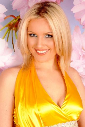 Ukrainian girl Alina,26 years old with grey eyes and blonde hair.