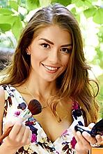 Ukrainian girl Natalie,31 years old with hazel eyes and light brown hair.