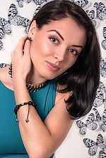 Ukrainian girl Victoria,24 years old with green eyes and black hair.