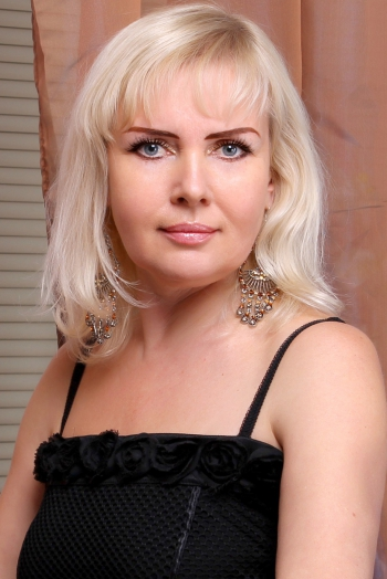 Ukrainian girl Viktoria,50 years old with blue eyes and blonde hair.